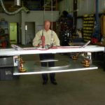 man operating vacuum lift assist