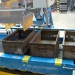blue conveyor system with baskets