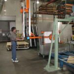 man operating vacuum lift