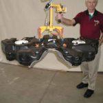 fuel tank raised by vacuum lift assist